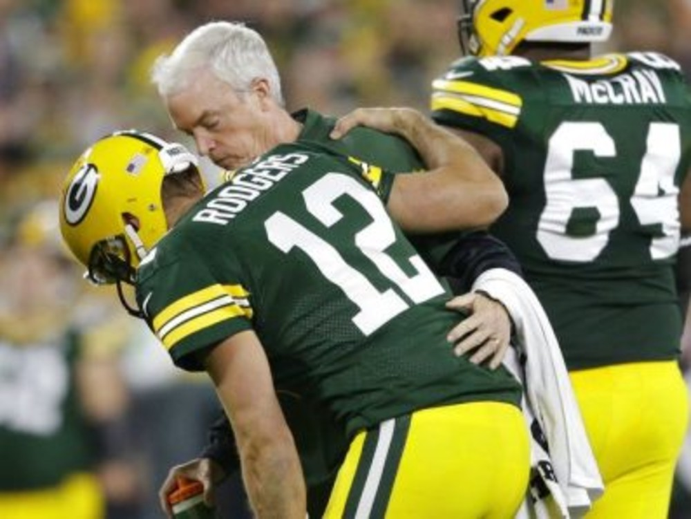 Green Bay Packers quarterback Aaron Rodgers is hurt after being sacked  during the first half of